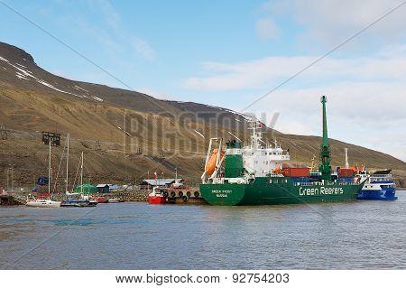 Cargo ship unloads at the harbor of Longyearbyen in Longyearbyen, Norway.