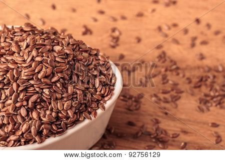 Flax Seeds Linseed In Bowl On Wooden Table