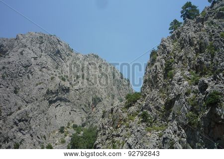Beautiful types, mountains, steep rocks, lakes and the mountain river - all this a canyon Geynyuk in Western Tartakh in Turkey poster