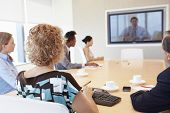 Group Of Businesspeople Having Video Conference In Boardroom poster