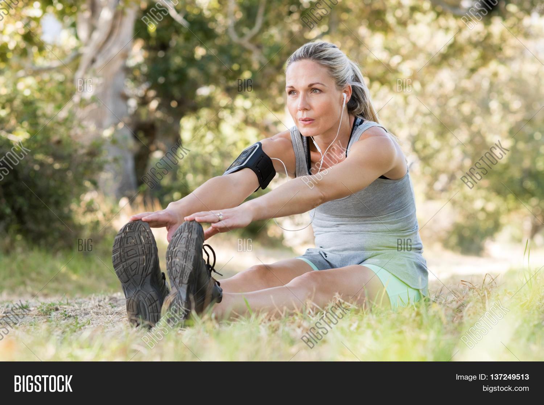 senior woman exercising park while image & photo | bigstock