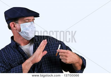 Man in mask fighting the urge to smoke
