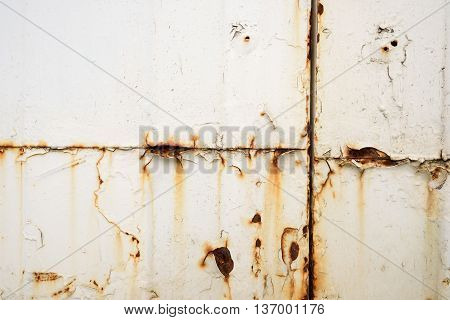 Rusting White Painted Metal Sheet Surface