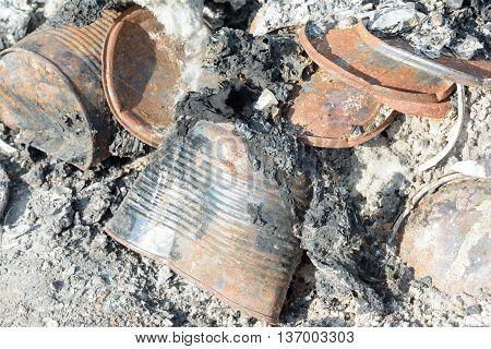 Burnt Tin Cars And Rubbish