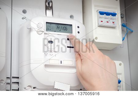 Electric Energy Meter. Electrical Technician Servicing Unit
