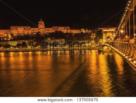 Buda Castle Chain Bridge Danube River Reflection Budapest Hungary. Buda Castle was first built in 1242 and enlarged by Empress Maria Theresa in the 1700s.