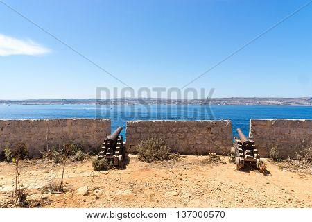 Santa Marija Battery canons on Comino overlooking the mediterranean sea towards Malta