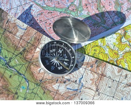 Compass map. The magnetic compass is located on a topographic map.