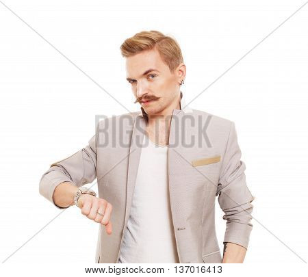 Man gesturing thumb down sign isolated at white. Young stylish guy with mustache in suit showing negative emotion. Sarcastic male portrait symbolising loss and failure, disapproving something.