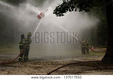 Buena Vista, New Jersey USA  July 1, 2016  A Firemen competition with a fire hose and barrel.