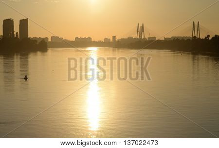 Cable stayed bridge and Neva river on the outskirts of St. Petersburg at sunset Russia. poster