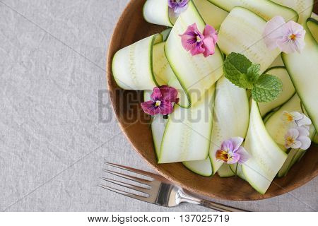 Zucchini salad with edible flowers summer vegan salad