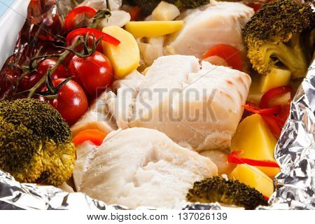 Fish dish - roasted fish fillets and vegetables