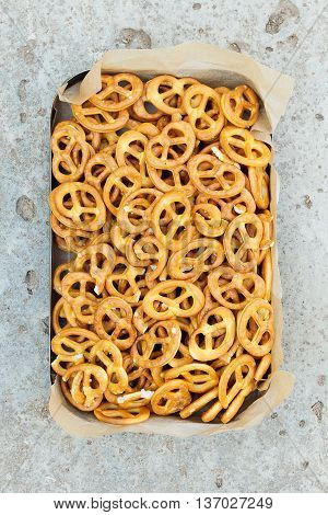 Pretzel. Background texture of salted savory mini pretzels in the traditional looped knot shape in a random heap viewed full frame from overhead