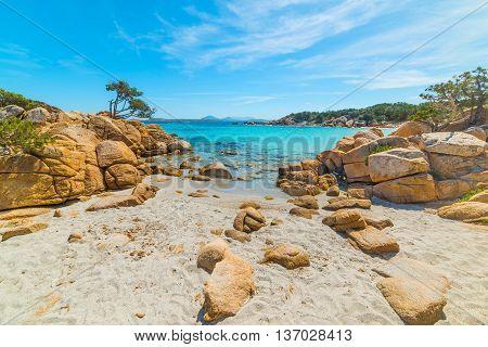 yellow rocks in Capriccioli beach in Costa Smeralda Italy