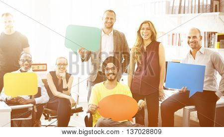Business Team Holding Speech Bubble Sign Concept