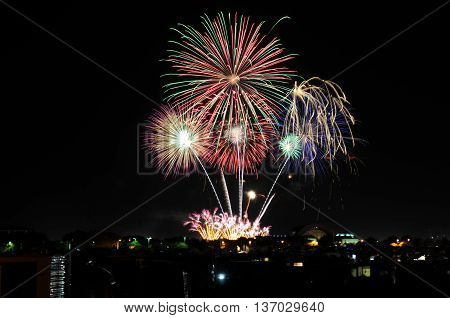 Fireworks Spectacular Pink, Purple, Green Color Display Against Black Night Sky