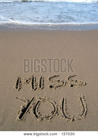 "words ""miss you"" written on the sand poster"