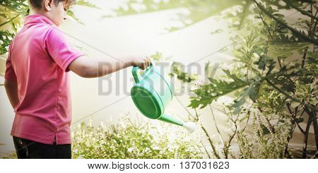 Boy Child Watering Flowers Help Concept