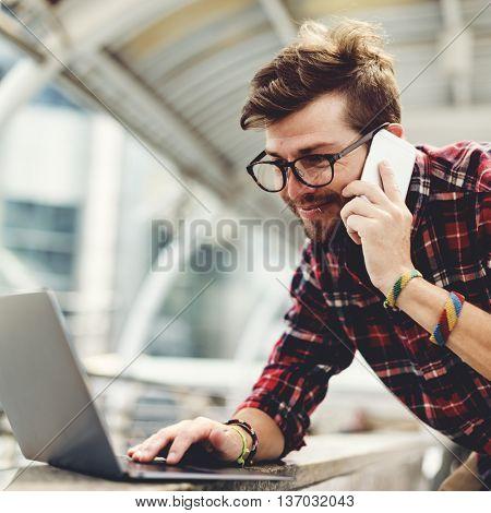 Man Talking Smartphone Browsing Laptop Concept