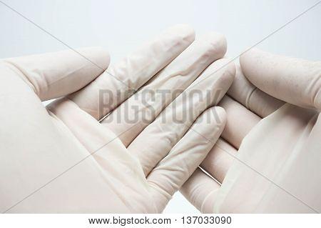 disposable sterile white gloves on white background