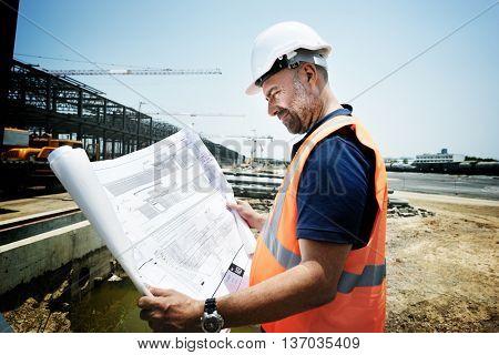 Construction Site Engineerer Working Blueprint Concept