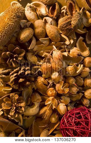 Aromatherapy potpourri dried plants and flowers nuts on a wooden background
