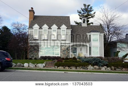 HARBOR SPRINGS, MICHIGAN / UNITED STATES - DECEMBER 25, 2015: An elegant home on East Bluff Drive in Harbor Springs, with a view of Little Traverse Bay.