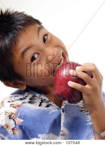 Child Biting On Apple