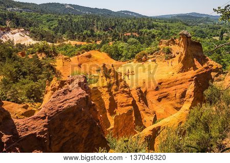 Picturesque orange and red hills. Quarry reserve - for ocher mining. Languedoc - Roussillon, Provence, France