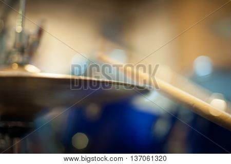 Hi hat cymbal detail golden metal with blurred effect of drum stick while hitting plate