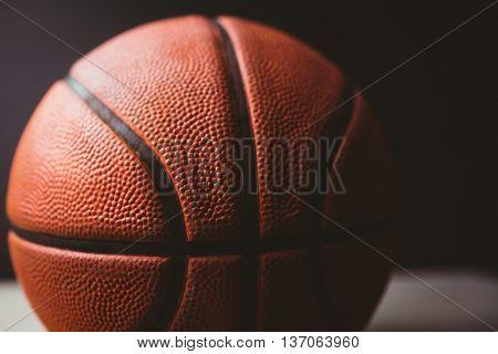 Close up of basketball on black background
