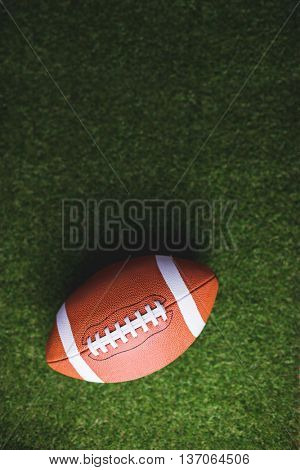 Close up of rugby ball on grass