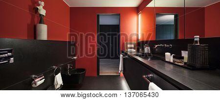 comfortable bathroom in modern design, red walls