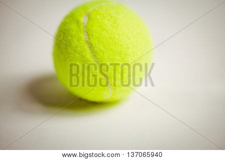 View of tennis ball on white background