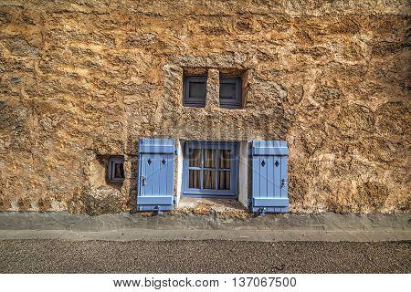small windows in a rustic wall in Sardinia Italy