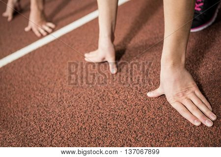 Run in ready position in gym