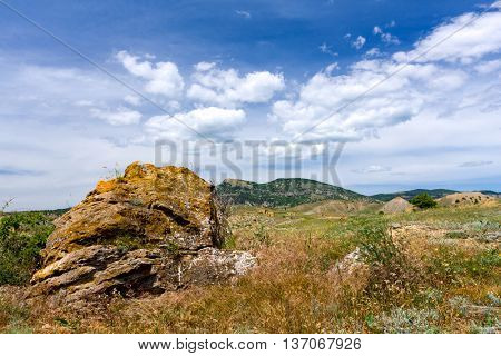 Landscape with old stone on mountain meadow