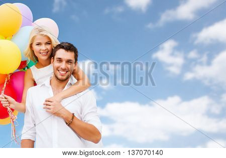 people, birthday, summer holidays, celebration and love concept - happy couple with balloons over blue sky background