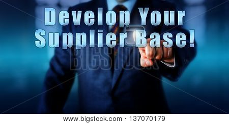 Corporate manager is pushing Develop Your Supplier Base! on a virtual screen. Business objectives concept motivational metaphor and call to action. Close up torso shot of man in blue suit.