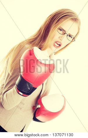 Beautiful business woman with boxing gloves.