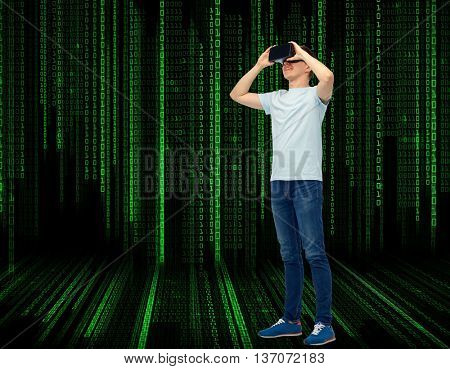 3d technology, virtual reality, entertainment, cyberspace and people concept - happy young man with virtual reality headset or 3d glasses over black background with binary code