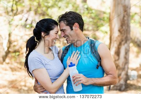 Portrait of a couple looking and holding each other on the wood