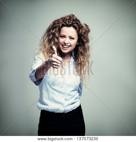Woman giving a thumbs up. Filtered image