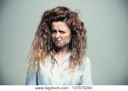 Woman making a disgusted expression. Filtered image