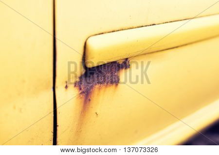 transport, corrosion and care concept - close up of rusty car door surface
