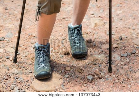 Close up on woman hikers foot on the wood
