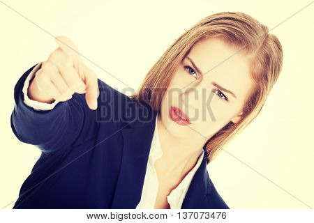 Beautiful business woman is showing warning sign.