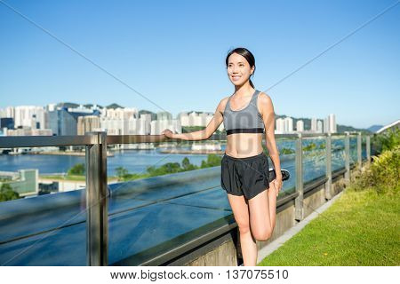 Young woman doing warm up exercise