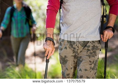 Close up of hiker walking on the wood